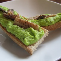 Broad bean purée and sardines on toast